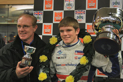Derek and Conor Daly with Conor's trophies