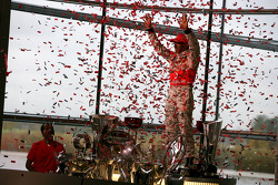 Lewis Hamilton celebrates with McLaren employees