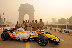 Members of the local forces pose with the Renault F1 R28