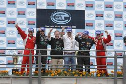 Drivers championship podium: GT1 champions Andrea Bertolini and Michael Bartels, GT2 champions Toni Vilander and Gianmaria Bruni