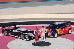 Sébastien Loeb and Stéphane Sarrazin pose with the Peugeot Sport Total Peugeot 908 and the Citroen Total WRT Citroen C4 WRC