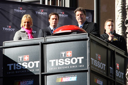 On the marquee of the Hard Rock Cafe in New York's Times Square, Tissot unveiled a clock counting down to the start of Tailgate City driven by Ford; kicking off the countdown on Wednesday were Tissot's U.S. Brand Manager Sharon Buntain, NASCAR Sprint Cup
