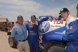 Car category winners Giniel De Villiers and Dirk Von Zitzewitz, celebrate with Volkswagen Motorsport director Kris Nissen