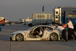 BMW Rahal Letterman Racing team members push their car to the transporter