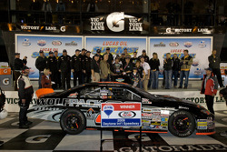Victory lane: race winner James Buescher celebrates
