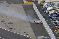 Joey Logano, Joe Gibbs Racing Toyota crashes in the wall exiting turn 4