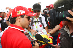Felipe Massa, Scuderia Ferrari being interviewed by a TV crew