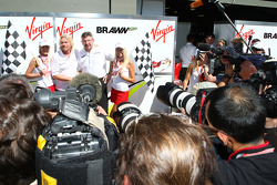 Sir Richard Branson CEO of the Virgin Group makes and announcement regarding the Virgin sponsorship deal with Brawn GP with Ross Brawn Brawn Grand Prix Team Principal