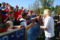 Sir Richard Branson CEO of the Virgin Group signing autographs