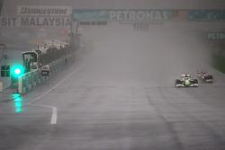 Jenson Button, Brawn GP and Timo Glock, Toyota F1 Team