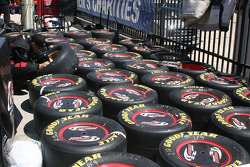 A Penske crew member works on tires