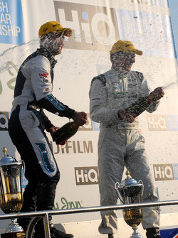 Adam and Plato spray the champagne