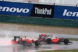 Lewis Hamilton, McLaren Mercedes leads Kimi Raikkonen, Scuderia Ferrari