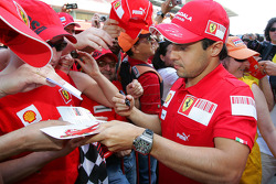 Felipe Massa, Scuderia Ferrari signing autographs for the fans