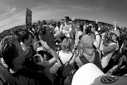 Timo Scheider, Matthias Ekström and Marco Werner surrounded by a sea of people