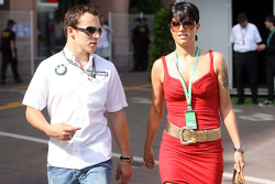 Christian Klien, Test Driver, BMW Sauber F1 Team walking with an girl