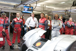 Dr. Wolfgang Ullrich and Audi Sport team members watch as Stéphane Sarrazin try to beat Allan McNish's pole