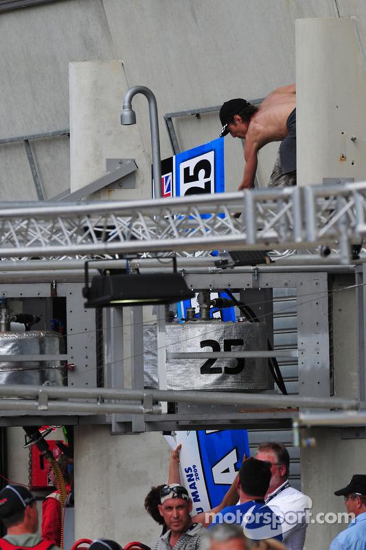 Fans take down pit signage