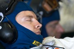 Aston Martin Racing team member takes a nap between pit stops