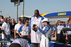 Luczo Dragon driver Raphael Matos gives Grand Marshal Shaquille O'Neal a lesson on an Indy Car steering wheel