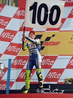 Podium: race winner Valentino Rossi, Fiat Yamaha Team celebrates 100th MotoGP win