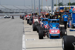 Silver Crown cars lined up in the pits