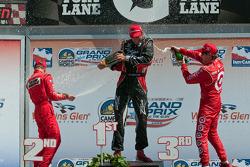 Podium: race winner Justin Wilson, Dale Coyne Racing, second place Ryan Briscoe, Team Penske, third place Scott Dixon, Target Chip Ganassi Racing
