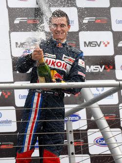 Mikhail Aleshin sprays champagne