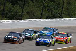 Denny Hamlin, Joe Gibbs Racing Toyota and Jimmie Johnson, Hendrick Motorsports Chevrolet battle for the lead
