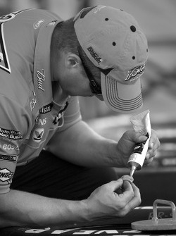 Richard Petty Motorsports Dodge crew member prepares the wheels