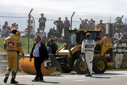 Track repairs at the Senna hairpin after the crash in the NASCAR Canadian Tire Series race