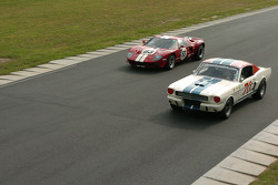 Hal McCarty's Gt350 about to be lapped by the #83- GT-40 of Archie Urciuoli