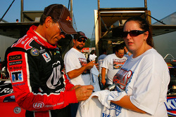 Ray Evernham, driver of the #98 signs autographs for a fan during practice