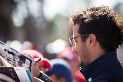 Daniel Ricciardo, Red Bull Racing signs autographs for the fans