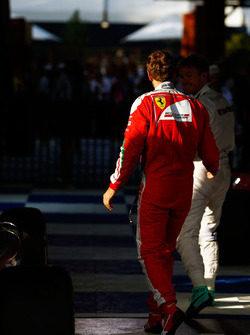Race winner Nico Rosberg, Mercedes AMG F1 celebrates in parc ferme with third placed Sebastian Vettel, Ferrari