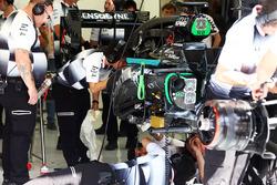 The McLaren MP4-31 of Stoffel Vandoorne, McLaren is worked on by mechanics
