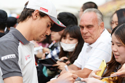 Esteban Gutierrez, Haas F1 Team signs autographs for the fans