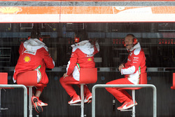 Ferrari engineers at work in the pit gantry