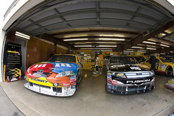 The M&M's Toyota and Carhartt Ford sit in their garage stalls
