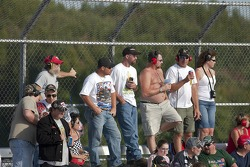 Fans watch the AAA 400 NASCAR Sprint Cup race