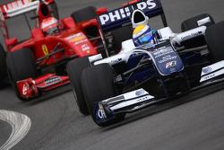 Nico Rosberg, Williams F1 Team and Kimi Raikkonen, Scuderia Ferrari