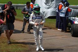 Nick Heidfeld, BMW Sauber F1 Team walks back after running out of fuel