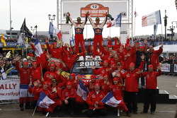 Podium: winners and 2009 WRC champions Sébastien Loeb and Daniel Elena celebrate with their team