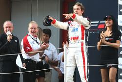Race winner Andy Soucek on the podium