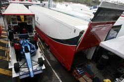 F2 Mechanics load the car of Armaan Ebrahim into the trucks