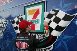 Jeff Gordon signs the pole winner wall at Texas Motor Speedway