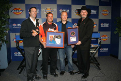 Space Shuttle Astronaut Col. Doug Hurley presents J.D. Gibbs, Greg Zipadelli  & Texas Motor Speedway President, Eddie Gossage are presented patches that flew in space about the space shuttle.
