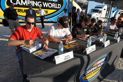 Kyle Busch, Ron Hornaday, Carl Edwards, Matt Crafton, Brad Keselowski and Mike Skinner sign autographs for fans