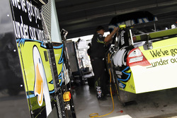 Carl Edward's Aflac Ford is prepped for the race by crew