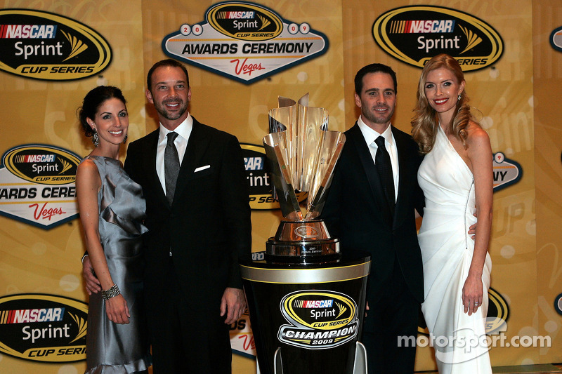 Crew chief Chad Knaus with his girlfriend Lisa Rockelmann, four time NASCAR Sprint Cup Series Champion Jimmie Johnson with his wife Chandra pose with the Sprint Cup